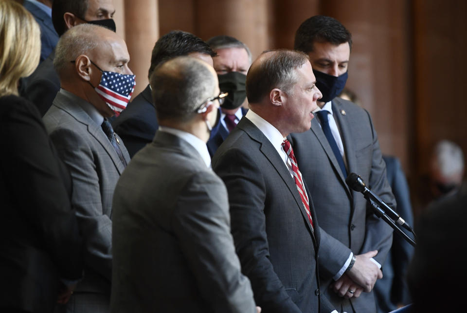 FILE - Assemblyman Minority Leader William A. Barclay, R- Fulton, second from right, stands with Assembly Republicans calling for the impeachment of New York Gov. Andrew Cuomo during a news conference at the Capitol, March 8, 2021, in Albany, N.Y. Gov. Andrew Cuomo, buffeted by sexual harassment allegations, is increasingly looking like he could be impeached and removed from office. A majority of members of the State Assembly, the legislative body that has the power to start impeachment proceedings, have already said they favor removing Cuomo if he won't resign. (AP Photo/Hans Pennink, File)