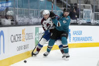 Colorado Avalanche center Nathan MacKinnon (29) battles for the puck against San Jose Sharks center Tomas Hertl (48) during the first period of an NHL hockey game in San Jose, Calif., on Wednesday, May 5, 2021. (AP Photo/Tony Avelar)