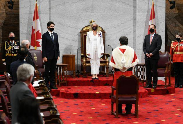 Gov. Gen. Julie Payette, middle, stands with Chief of Defence Staff Jonathan Vance, left to right, Prime Minister Justin Trudeau, Senator Marc Gold, and RCMP Commissioner Brenda Lucki during the throne speech in the Senate chamber in Ottawa on Wednesday.