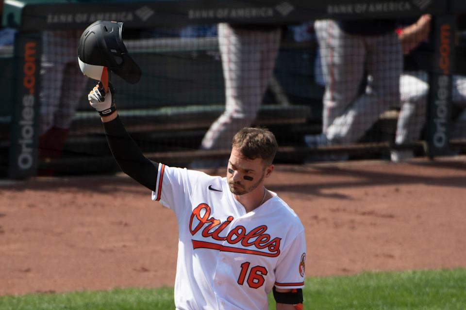 Baltimore Orioles right fielder Trey Mancini tips his helmet during his first at-bat against the Boston Red Sox at Oriole Park at Camden Yards.