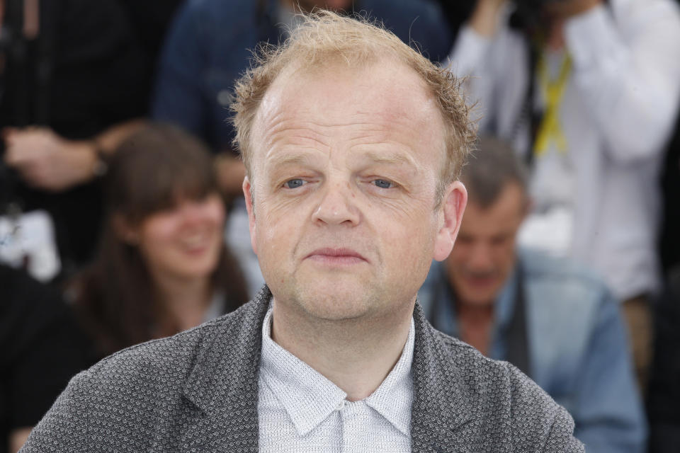 """FILE - In this Thursday, May 14, 2015 file photo, actor Toby Jones poses during a photo call for the film Tale of Tales, at the 68th international film festival, Cannes, southern France. The Queen's New Year honors list was annouced Wednesday, Dec. 30, 2020. Actress Lesley Manville, an Oscar nominee for """"Phantom Thread,"""" was named a Commander of the Order of the British Empire, or CBE. Actor Toby Jones, whose credits include Dobby in the """"Harry Potter"""" movies, was made an Officer of the Order of the British Empire or OBE, as was writer Jed Mercurio, creator of gripping TV detective series """"Line of Duty."""" (AP Photo/Lionel Cironneau,file)"""