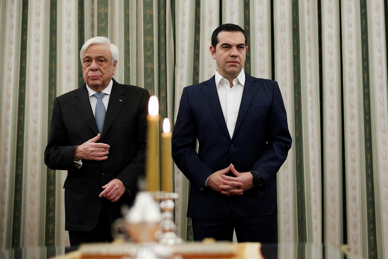 Greek Prime Minister Alexis Tsipras and Greek President Prokopis Pavlopoulos attend a swearing-in ceremony of the newly appointed members of the government at the Presidential Palace in Athens, Greece February 18, 2019. REUTERS/Costas Baltas