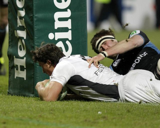 Toulouse's Yannick Jauzion (L) scores a try against Glasgow Warriors during a Heineken Cup, pool six, rugby union match at Firhill Stadium in Glasgow on December 10, 2010. AFP PHOTO / GRAHAM STUART (Photo credit should read GRAHAM STUART/AFP/Getty Images)