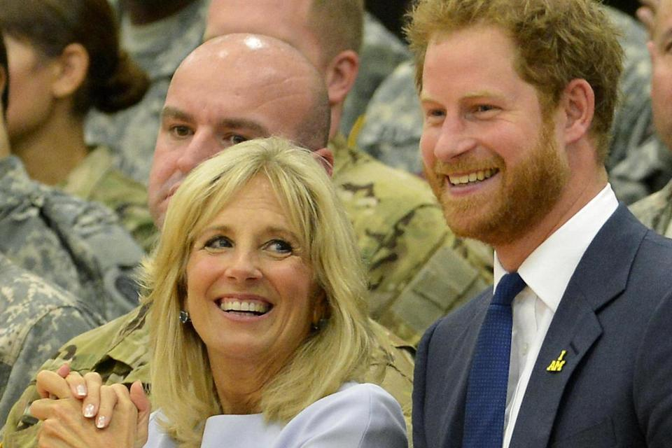 Prince Harry and Dr. Jill Biden stand at the conclusion of a basketball game by wounded service members, October 28, 2015, at Ft. Belvoir, Virginia. The event is a celebration of the Joining Forces Initiative and the upcoming 2016 Invictus Games in Orlando, Florida, in which wounded military personnel compete in sporting competitio