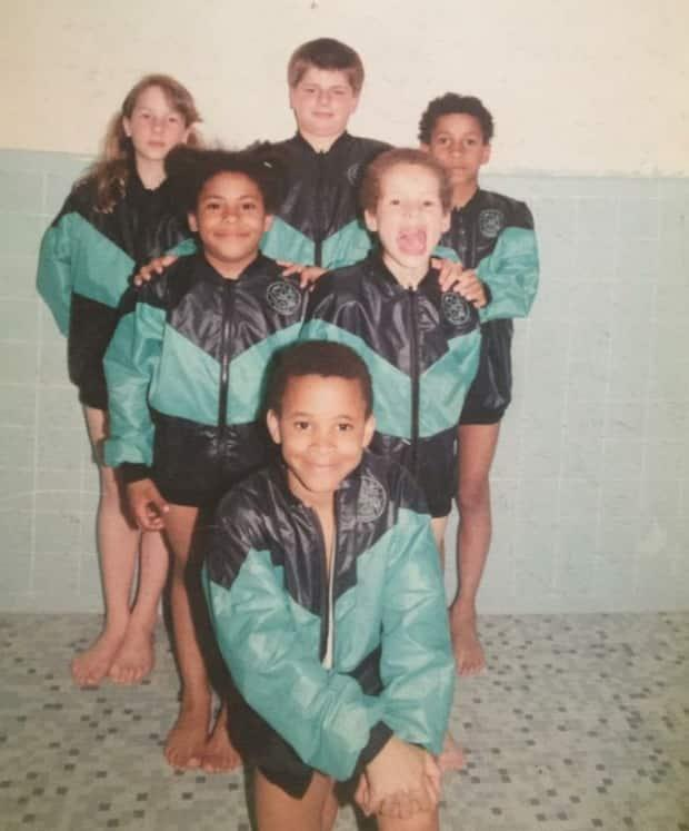 Krystina Alogbo, middle left, appears with her childhood swim team, made up of siblings and cousins.