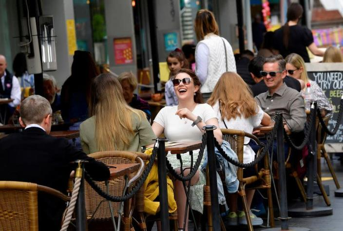 FILE PHOTO: People relax at outdoor dining areas as lockdown restrictions continue to ease in London
