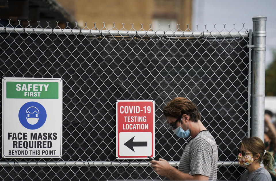 Patients wait on line outside a COVID-19 testing site that provides priority testing for NYC Department of Education staff through NYC Health + Hospitals on Ft. Hamilton Parkway, Wednesday, Oct. 7, 2020, in the Borough Park neighborhood of the Brooklyn borough of New York. (AP Photo/John Minchillo)