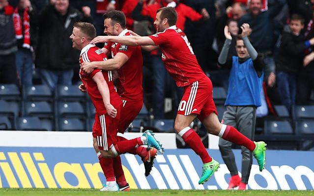 Jonny Hayes (L) celebrates scoring the winning goal - Getty Images Europe