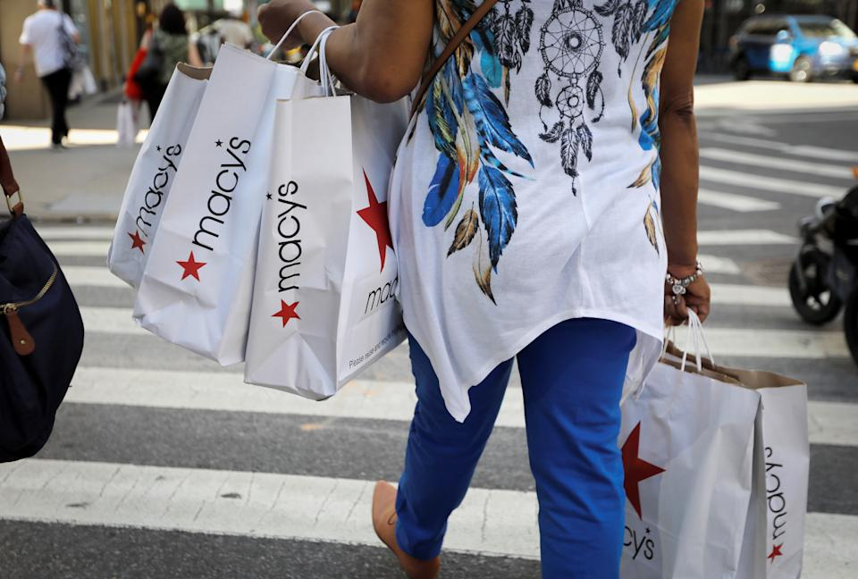 A woman carries shopping bags from Macy's department store in midtown Manhattan following the outbreak of the coronavirus disease (COVID-19) in New York City, New York, U.S., July 9, 2020. REUTERS/Mike Segar
