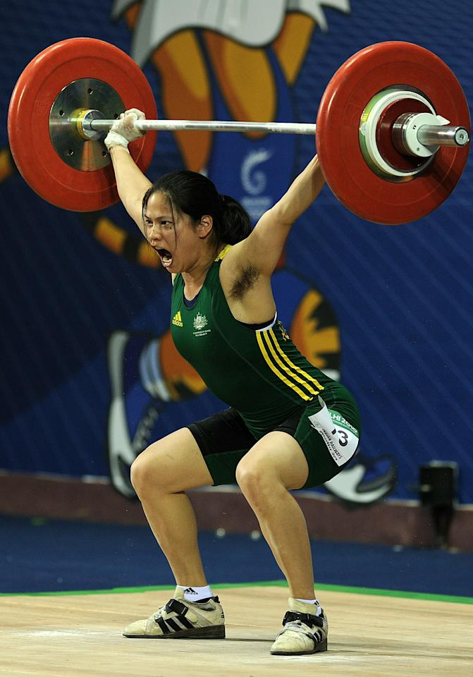 Australia's Seen Lee attempts a lift during the women's 58 kg weightlifting snatch event during the Commonwealth Games at Jawaharlal Nehru sports complex in New Delhi on October 6, 2010. The Indian capital is hosting the October 3-14 Commonwealth Games, the biggest sporting event in the city since the 1982 Asian Games. AFP PHOTO/ Manpreet ROMANA (Photo credit should read MANPREET ROMANA/AFP/Getty Images)