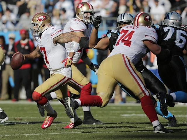 San Francisco 49ers quarterback Colin Kaepernick (7) moves out of the pocket against the Carolina Panthers during the first half of a divisional playoff NFL football game, Sunday, Jan. 12, 2014, in Charlotte, N.C. (AP Photo/Chuck Burton)