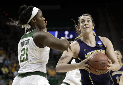 Baylor's Kalani Brown (21) works against a drive to the basket by Michigan's Hallie Thome, right, in the first half of a second-round game at the NCAA women's college basketball tournament in Waco, Texas, Sunday, March 18, 2018. (AP Photo/Tony Gutierrez)