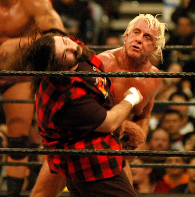 <p>Mick Foley and Ric Flair in action during a wrestling event. (Photo by Djamilla Rosa Cochran/WireImage) </p>