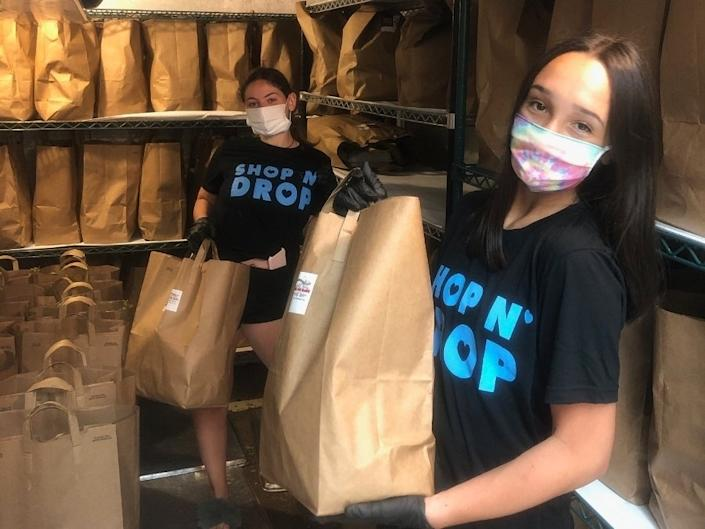 With the help of donations from local residents and businesses, a group of high school students launched Project Shop N' Drop, which has provided more than 3,600 bags of groceries to 477 people since early May. (Courtesy Ida Fiore)