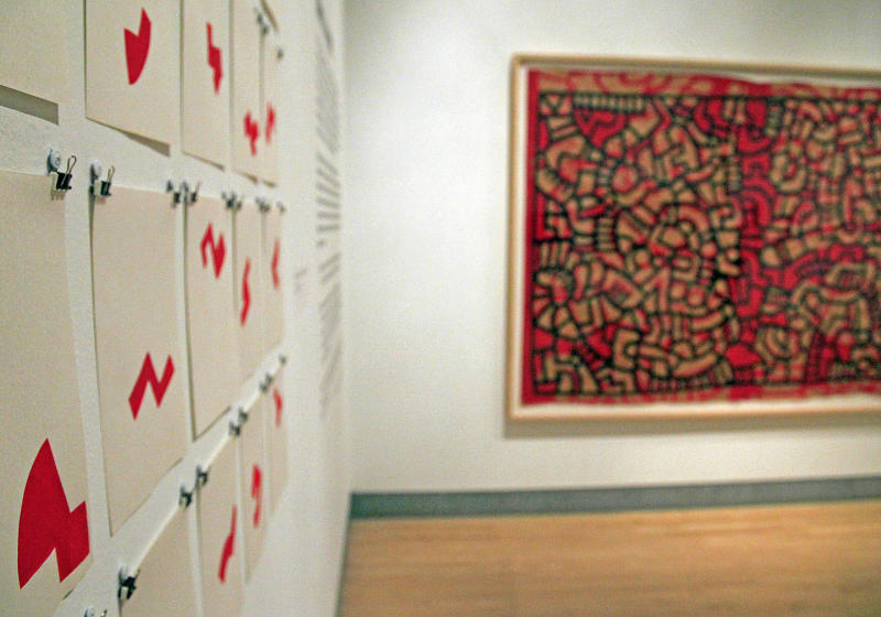 """In this March 14, 2012 photo, installations of art by Keith Haring hang on display before the opening of the exhibition """"Keith Haring: 1978-1982"""" at the Brooklyn Museum in New York. The exhibition chronicles the period in Haring's career from his arrival in New York through the years making public and political art on city streets. (AP Photo/Bebeto Matthews)"""