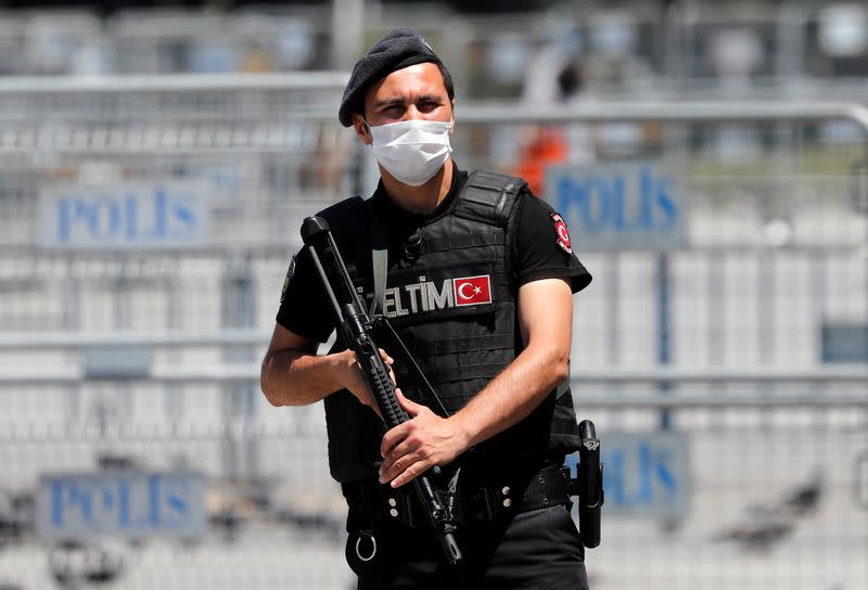 A Turkish riot police officer stands guard in front of the Justice Palace in Istanbul