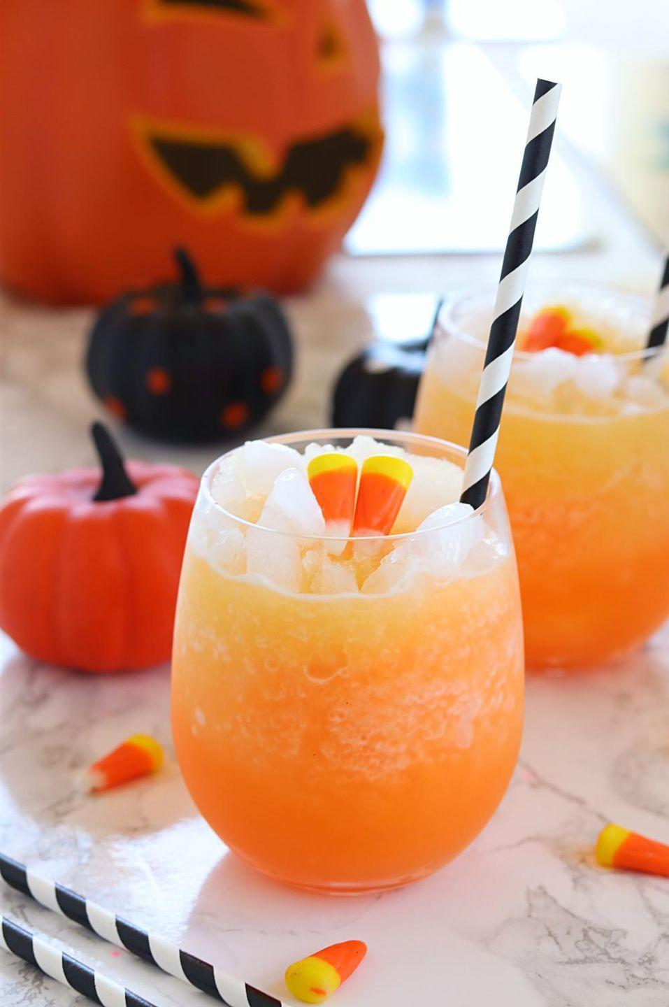 """<p>Here's another festive sherbet punch option for orange fanatics! This one is decked out with candy corns for an extra jolt of sweetness.</p><p><strong>Get the recipe at <a href=""""https://www.ruchiskitchen.com/halloween-orange-sherbet-punch/"""" rel=""""nofollow noopener"""" target=""""_blank"""" data-ylk=""""slk:Ruchi's Kitchen"""" class=""""link rapid-noclick-resp"""">Ruchi's Kitchen</a>.</strong></p><p><strong><a class=""""link rapid-noclick-resp"""" href=""""https://www.amazon.com/dp/B01DCGTNRE/?tag=syn-yahoo-20&ascsubtag=%5Bartid%7C2164.g.36792938%5Bsrc%7Cyahoo-us"""" rel=""""nofollow noopener"""" target=""""_blank"""" data-ylk=""""slk:SHOP BLACK AND WHITE PAPER STRAWS"""">SHOP BLACK AND WHITE PAPER STRAWS</a><br></strong></p>"""