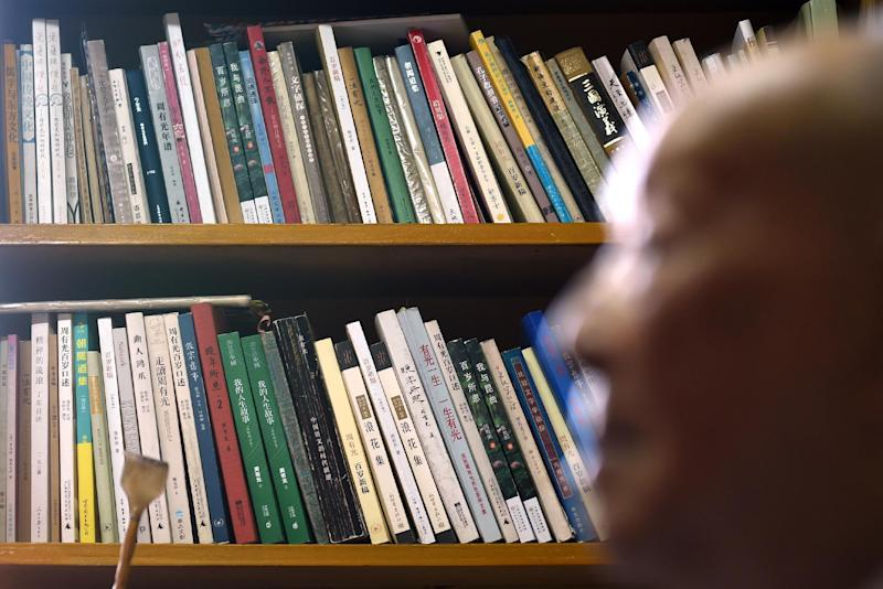 """Zhou Youguang, commonly known as the """"father of Pinyin"""", sits in front of a bookshelf at his home in Beijing on January 11, 2015 (AFP Photo/Wang Zhao)"""