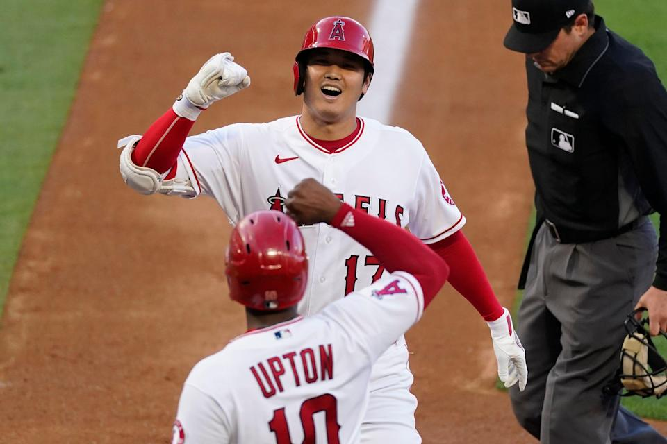 Los Angeles Angels designated hitter Shohei Ohtani (top) celebrates his home run with Justin Upton.