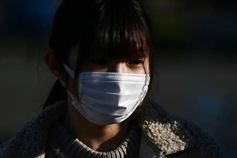 Face masks are a common sight in Japan (AFP Photo/CHARLY TRIBALLEAU)