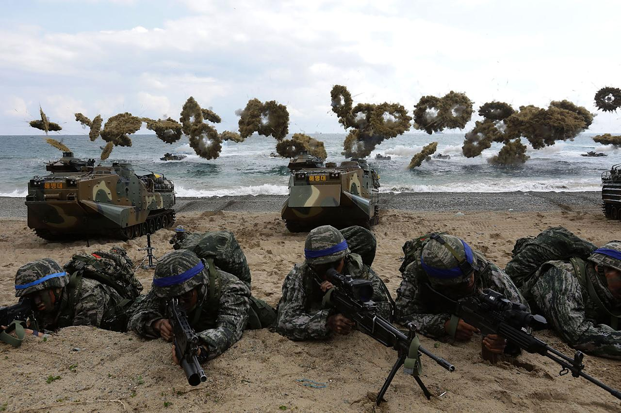 <p>South Korean marines participate in a landing operation referred to as Foal Eagle joint military exercise with U.S. troops on April 2, 2017, in Pohang, South Korea. (Photo: Chung Sung-Jun/Getty Images) </p>