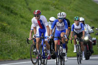 Juraj Sagan of Slovakia, left, competes during the men's cycling road race at the 2020 Summer Olympics, Saturday, July 24, 2021, in Oyama, Japan. (AP Photo/Christophe Ena)