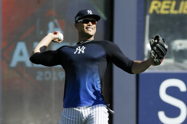 New York Yankees left fielder Giancarlo Stanton throws in the outfield before Game 3 of baseball's American League Championship Series against the Houston Astros, Tuesday, Oct. 15, 2019, in New York. (AP Photo/Matt Slocum)