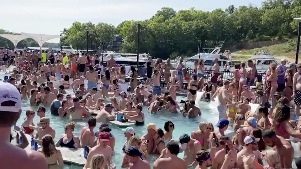 Revelers celebrate Memorial Day weekend at Osage Beach of the Lake of the Ozarks, Missouri, U.S., May 23, 2020 in this screen grab taken from social media video and obtained by Reuters on May 24, 2020. (Lawler50/Twitter via Reuters)