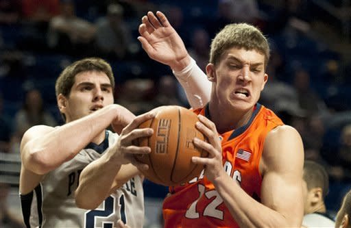 Illnois center Meyers Leonard (12) holds on to the ball next to Penn State's Sasa Borovnjak (21) during the first half of an NCAA college basketball game in State College, Pa., Thursday, Jan. 19, 2012. (AP Photo/Andy Colwell)