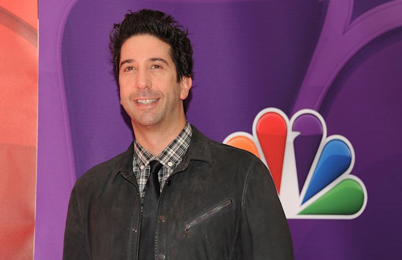 """FILE - In this May 13, 2013 file photo, actor David Schwimmer attends the NBC Network 2013 Upfront at Radio City Music Hall in New York. Before he became a famous TV star on """"Friends,"""" actor and director Schwimmer helped start a theater company in Chicago with a group of his Northwestern University classmates. Schwimmer has returned to direct the company's summer offering, a crime comedy called """"Big Lake, Big City"""" written by Keith Huff of TV's """"Mad Men"""" and Broadway's """"A Steady Rain."""" (Photo by Evan Agostini/Invision/AP, File)"""