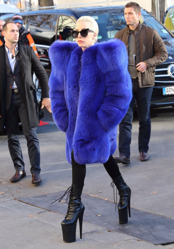 """<p>Lady Gaga takes fur to another level having recently sported Saint Laurent's bank-breaking fox coat. In 2012, she wrote an open letter defending her decision to wear real fur: """"I have truly always stayed away from skinned fur, but this does not mean my morals are rigid and that I won't bend at the sight of an absolute art piece of a coat."""" <i>[Photo: Twitter/AudreyofNY]</i> </p>"""