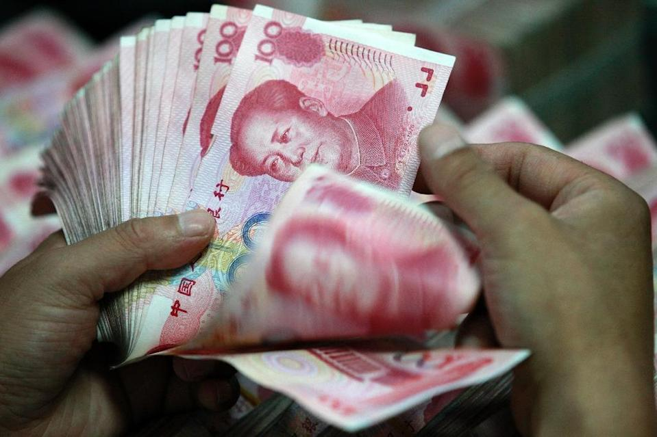 The Chinese market was given some support by the People's Bank of China's decision to increase the yuan's rate against the dollar (AFP Photo/)