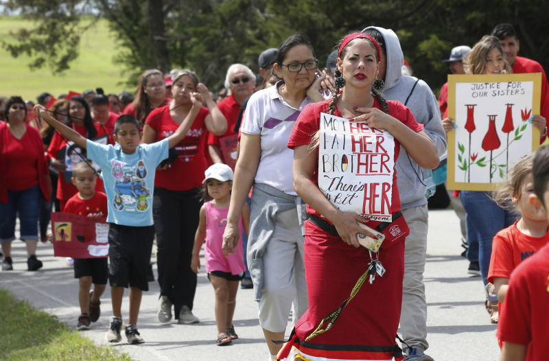 """FILE - In this Friday, June 14, 2019, file photo, Miranda Muehl, of Mustang, Okla., marches during a march to call for justice for missing and murdered indigenous women at the Cheyenne and Arapaho Tribes of Oklahoma in Concho, Okla. U.S. Senate staffers say officials missed a second deadline on July 8 to offer input on bills on Native American safety, and only one department has since provided """"partial comment."""" (AP Photo/Sue Ogrocki, File)"""