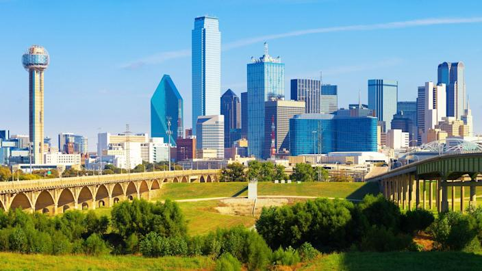 view of the skyline of Dallas financial district during a beautiful bright blue day.