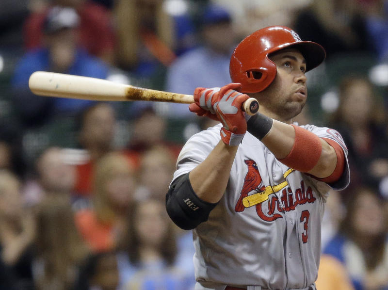 St. Louis Cardinals' Carlos Beltran watches his sacrifice fly during the 10th inning of a baseball game against the Milwaukee Brewers on Friday, Sept. 20, 2013, in Milwaukee. Kolten Wong scored from third. (AP Photo/Morry Gash)