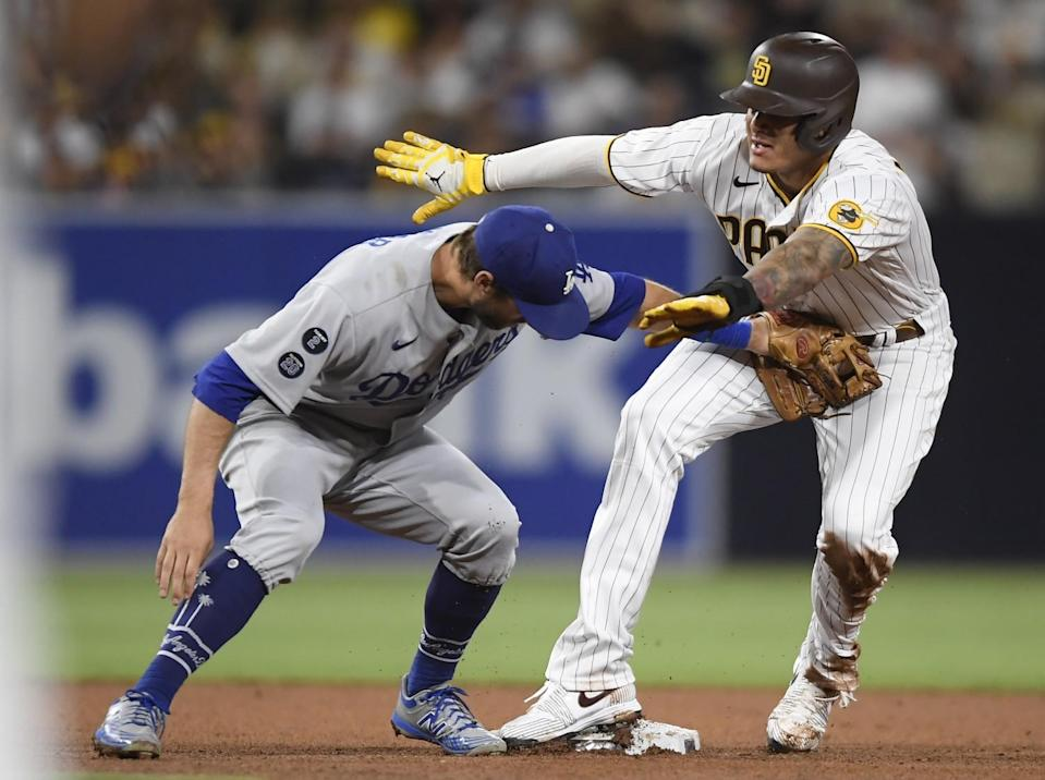 The Padres' Manny Machado steals second base ahead of the tag of Dodgers second baseman Chris Taylor.