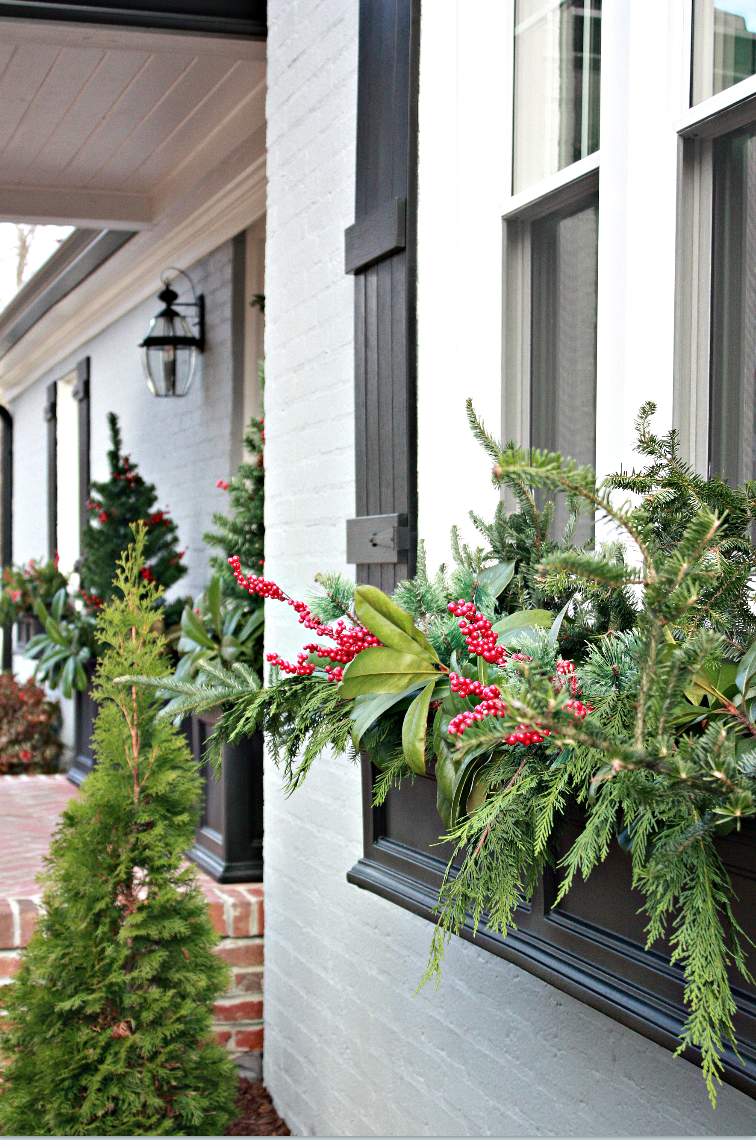 """<p>Can you believe all the greenery used in this beautiful Christmas window box only added up to $5? Yeah, neither can we.</p><p><strong>Get the tutorial at <a href=""""https://www.nestofposies-blog.com/2017/12/how-to-decorate-christmas-window-boxes-and-outdoor-garland/"""" rel=""""nofollow noopener"""" target=""""_blank"""" data-ylk=""""slk:Nest of Posies."""" class=""""link rapid-noclick-resp"""">Nest of Posies.</a></strong></p>"""