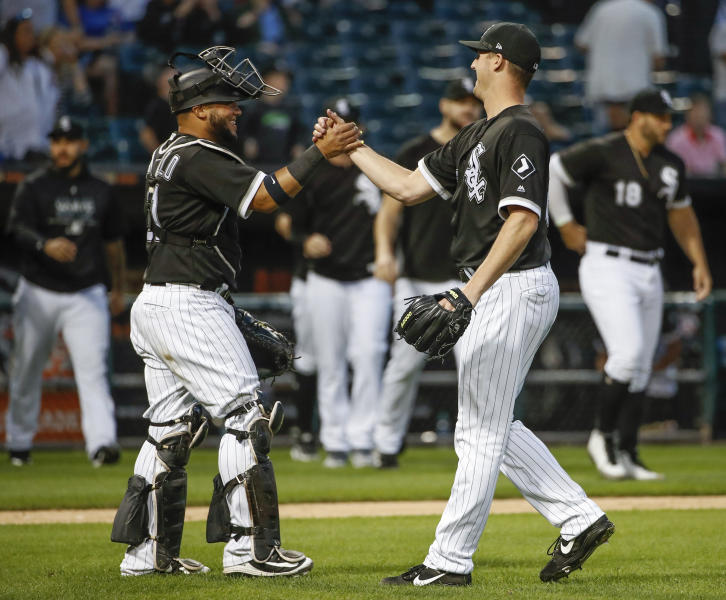 Chicago White Sox's Nate Jones, right, celebrates with Welington Castillo, left, after the White Sox defeated the Chicago Cubs in a baseball game Friday, Sept. 21, 2018, in Chicago. (AP Photo/Kamil Krzaczynski)