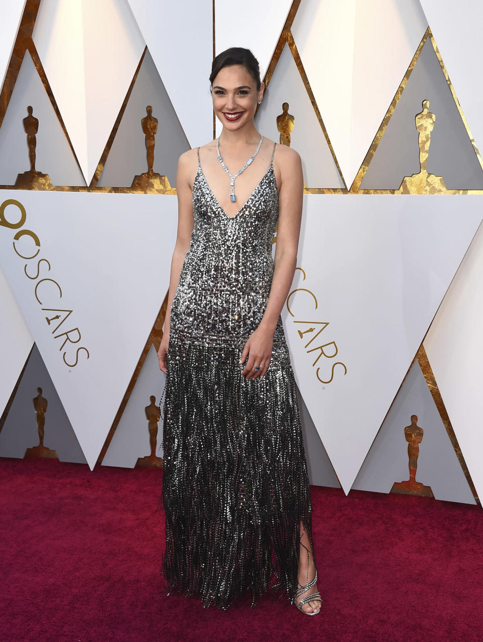 <p>Gal Gadot accessorized her decolletage with a large pendant. (Photo by Jordan Strauss/Invision/AP) </p>