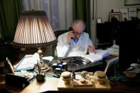 Kormendi, 97-year-old doctor, talks on phone in his doctor's office at his home in Budapest