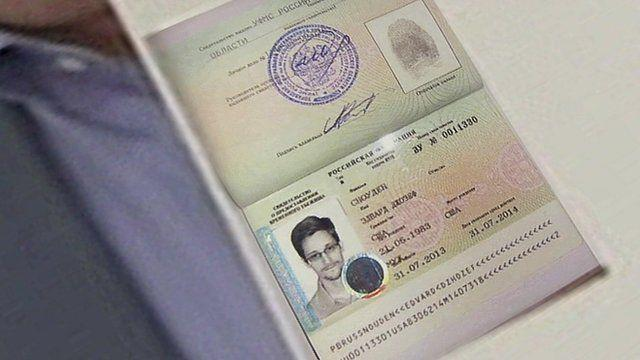 Kucherena holds up Snowden's passport to show journalists the asylum stamp granted by Russia on Aug. 1, 2013. (Photo: APTV via AP)