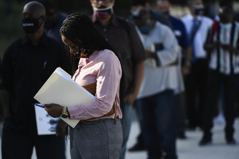 People wear face masks as they wait in line to attend a job fair for employment with SoFi Stadium and Los Angeles International Airport employers, at SoFi Stadium on September 9, 2021, in Inglewood, California. - Fewer Americans made new claims for unemployment benefits last week than at any point since the Covid-19 pandemic began, according to government data released on September 9, the latest sign of progress in the job market following last year's mass layoffs. (Photo by Patrick T. FALLON / AFP) (Photo by PATRICK T. FALLON/AFP via Getty Images)