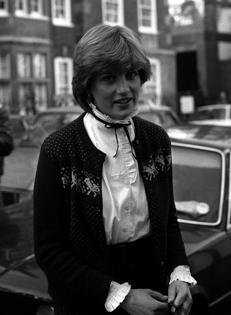 """<p>Dubbed """"Shy Di"""" by the media, Diana was thrust into the spotlight just days after meeting Prince Charles. And in the early eighties, the twenty-something donned twee pie-crust collars and Fair Isle knits. But what really accompanied the innocent aesthetic was her now iconic blonde bouffant.<br><em>[Photo: PA]</em> </p>"""