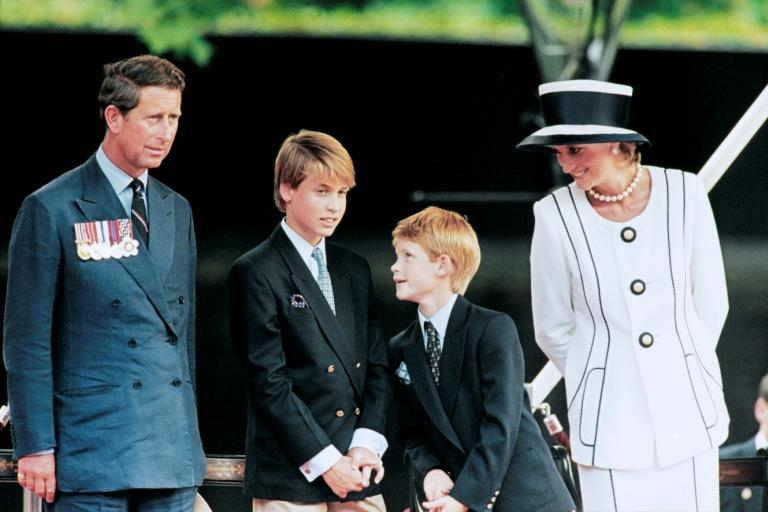 Prince Charles, Princess Diana and their children William and Harry take part in commemorations for VJ Day in London in 1995