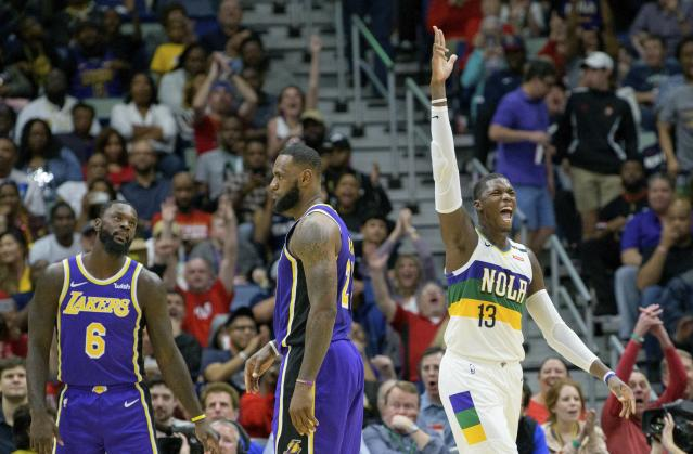 Even without Anthony Davis in the lineup, the Pelicans had no problem rolling over LeBron James and the Lakers on Saturday night. (AP Photo/Matthew Hinton)