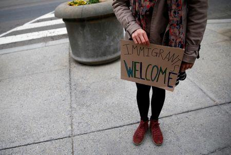 FILE PHOTO - An immigration activist outside of the U.S. Customs and Border Protection headquarters in Washington