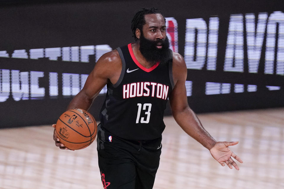 Houston Rockets' James Harden (13) argues a call during the first half of an NBA conference semifinal playoff basketball game against the Los Angeles Lakers Saturday, Sept. 12, 2020, in Lake Buena Vista, Fla. (AP Photo/Mark J. Terrill)