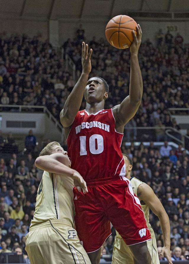 Wisconsin's Nigel Hayes (10) moves past Purdue's Travis Carroll (50) to take a shot in the first half of an NCAA college basketball game, Saturday, Jan. 25, 2014, in West Lafayette, Ind. (AP Photo/Doug McSchooler)