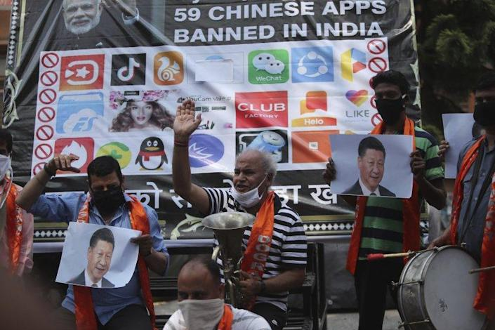 """Activists denounce Chinese President Xi Jinping during a protest in Jammu, India, on July 1, 2020, after the Indian government banned dozens of Chinese-made apps. <span class=""""copyright"""">(Channi Anand / Associated Press)</span>"""