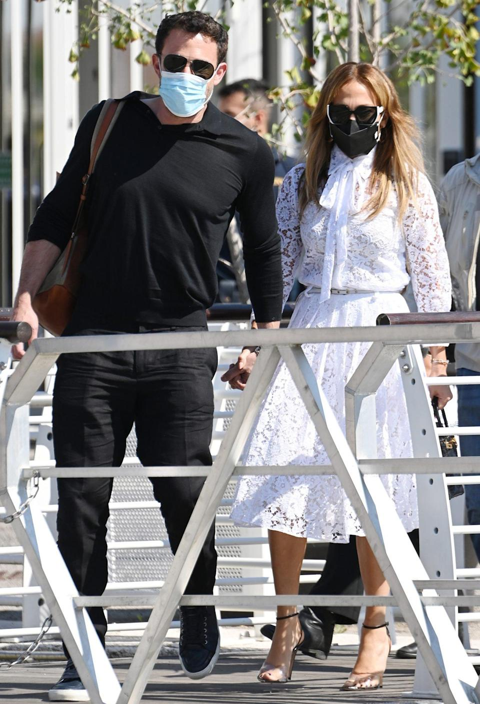 <p>Ahead of the premiere, the duo arrived in Venice masked up and hand-in-hand (and in the same color combination, one might add). </p>
